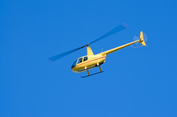 """Yellow Robinson R-44 """"Raven"""" helicopter"""