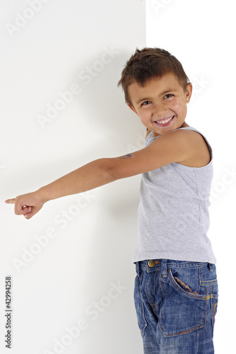 little boy pointing on the blank space