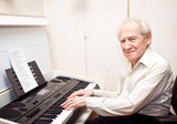 Pleased Senior Man Playing Piano