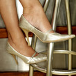 Close up of a pair of shiny high heel