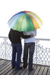 Guys sharing umbrella