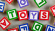 Wooden blocks forming the word TOYS in the center
