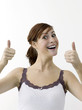 Happy woman showing double thumbs up