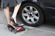Woman pumping a flat tire