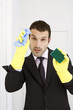 Businessman with rubber gloves, sponge and a cloth