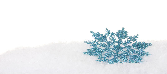 beautiful snowflake in the snow isolated on white