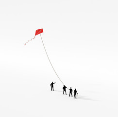 Tiny people holding a kite