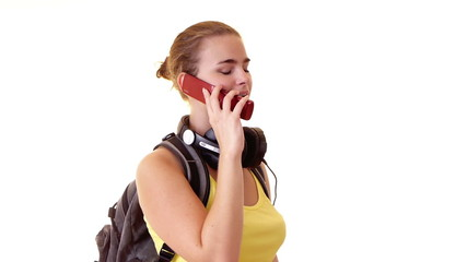 student with headphones and backpack calling by cellphone
