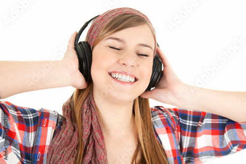enjoy young girl listening music in headphones
