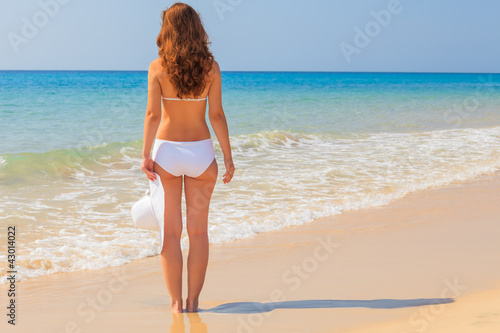 Young woman enjoy sun on the beach