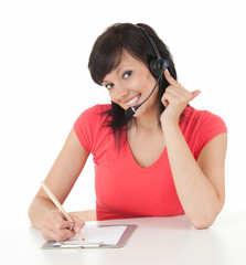 young woman in headset from call center smiling