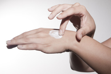 woman hands with vanishing creme