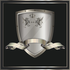 Decorative shield with decorative ribbon.