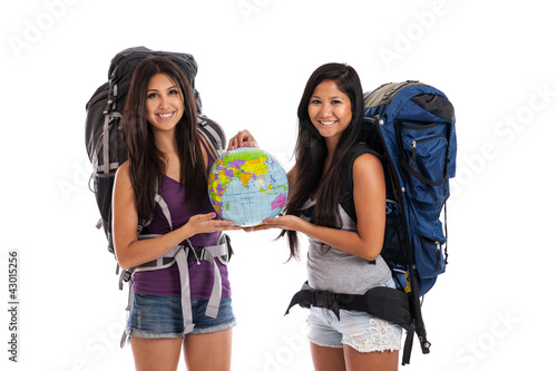 Young backpackers with globe