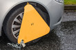 Yellow wheel clamp on illegally parked car