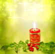 Christmas burning red candle and evergreen background