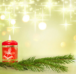 Christmas candle and holly background concept