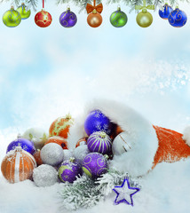 Christmas santa claus hat baubles and snow concept