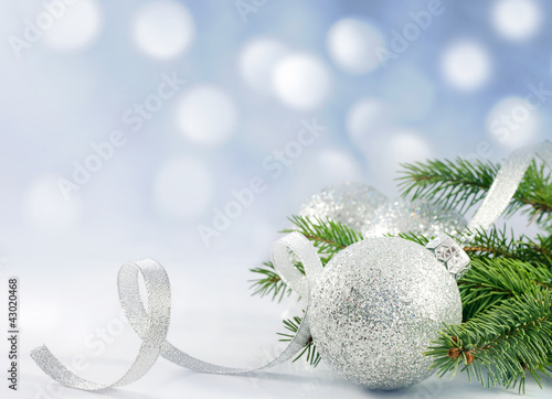 Christmas branch of tree ribbon  bauble and snow