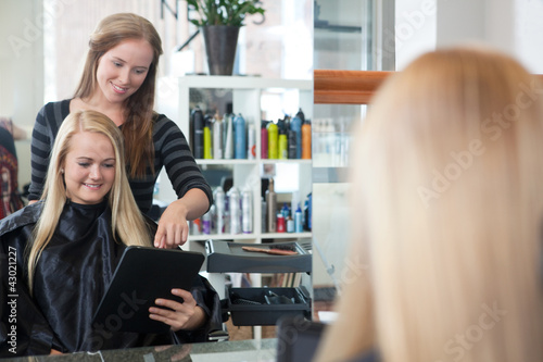 Customer with Digital Tablet at Hair Salon