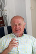 Healthy happy pensioner drinking water