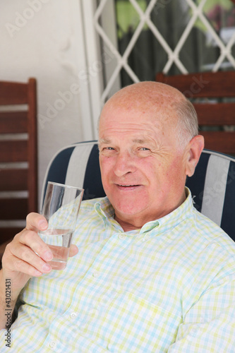 Thirsty senior man drinking water
