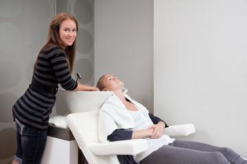 Woman Receiving Hair Wash at Beauty Salon