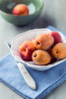 Fresh apricots in a small bowl