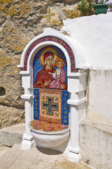 Fountain decorated with mosaics. Ostrog Monastery.