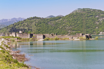 Remains of ancient fortress on shore of Skadar Lake. Montenegro.