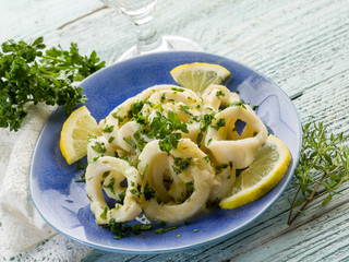 rings squid with parsley and lemon