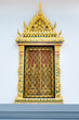 Ancient Golden carving wooden door of Thai temple