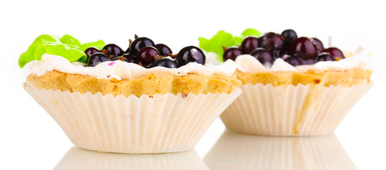 sweet cakes with berries isolated on white