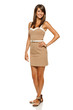 Full length of trendy young woman in elegant beige dress