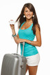 Woman in casual standing with silver travel bag and credit card