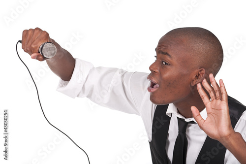 man singing with his hand behing the ear