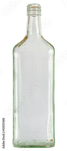 Close up of a empty vodka glass bottle isolated on white