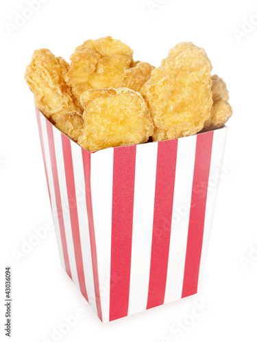 Fried chicken nuggets in red white striped box