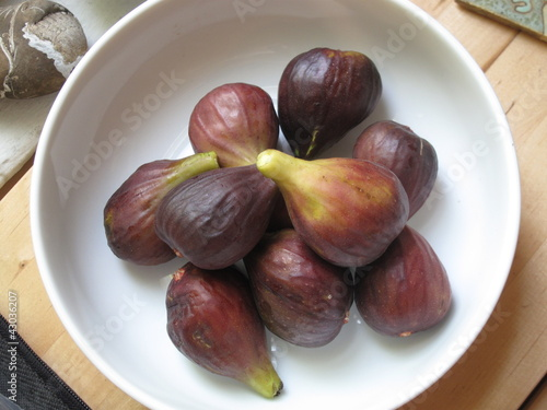 Fresh picked summer figs in kitchen bowl