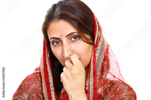 Indian lady with thoughtful expression