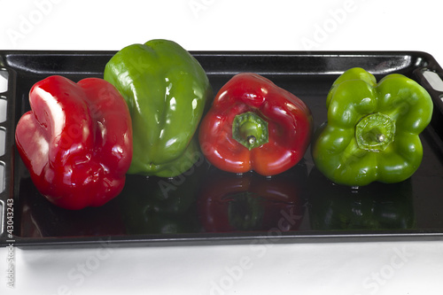 Four peppers on a oven tray