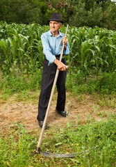 Senior farmer with scythe