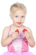 Little girl eating strawberries on white