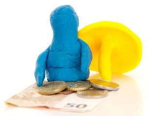 Knetgummifigure mit Schirm und Geld / Modelling clay figure with