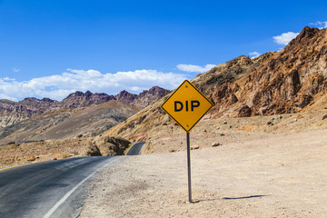 scenic road Artists Drive in Death valley with colorful stones,