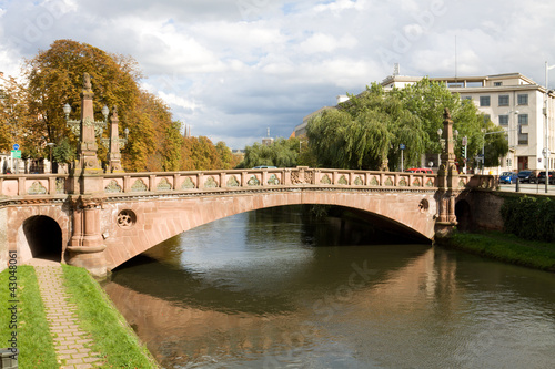 Beautiful cityscape in Strasbourg with a bridge over Ill river