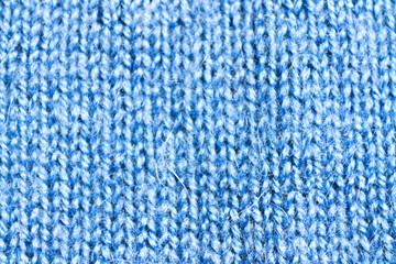 the texture of blue wool knit braid