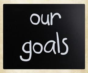 """Our goals"" handwritten with white chalk on a blackboard"