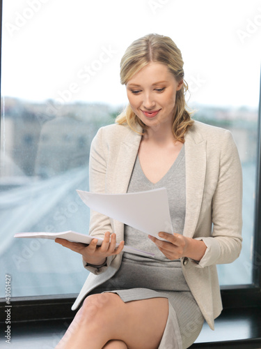 happy woman with documents