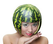 Funny woman with water-melon as helmet